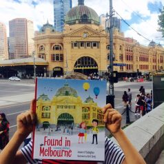 Xavier at Flinders St with book